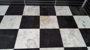 Badly stained and soiled vinyl tiles